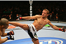 MONTREAL, QC - MARCH 16:  T.J. Dillashaw kicks Issei Tamura in their bantamweight bout during the UFC 158 event at Bell Centre on March 16, 2013 in Montreal, Quebec, Canada.  (Photo by Jonathan Ferrey/Zuffa LLC/Zuffa LLC via Getty Images)