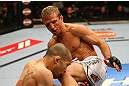 MONTREAL, QC - MARCH 16:  T.J. Dillashaw knees Issei Tamura in their bantamweight bout during the UFC 158 event at Bell Centre on March 16, 2013 in Montreal, Quebec, Canada.  (Photo by Jonathan Ferrey/Zuffa LLC/Zuffa LLC via Getty Images)