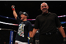 MONTREAL, QC - MARCH 16: T.J. Dillashaw celebrates his win over Issei Tamura in their bantamweight bout during the UFC 158 event at Bell Centre on March 16, 2013 in Montreal, Quebec, Canada.  (Photo by Jonathan Ferrey/Zuffa LLC/Zuffa LLC via Getty Images)