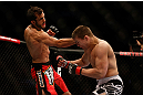 MONTREAL, QC - MARCH 16: (L-R) Quinn Mulhern lands a punch against Quinn Mulhern in their welterweight bout during the UFC 158 event at Bell Centre on March 16, 2013 in Montreal, Quebec, Canada.  (Photo by Jonathan Ferrey/Zuffa LLC/Zuffa LLC via Getty Images)