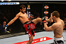 MONTREAL, QC - MARCH 16: Quinn Mulhern throws a front kick against Rick Story in their welterweight bout during the UFC 158 event at Bell Centre on March 16, 2013 in Montreal, Quebec, Canada.  (Photo by Jonathan Ferrey/Zuffa LLC/Zuffa LLC via Getty Images)