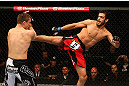MONTREAL, QC - MARCH 16: (R-L) Quinn Mulhern lands a kick against Quinn Mulhern in their welterweight bout during the UFC 158 event at Bell Centre on March 16, 2013 in Montreal, Quebec, Canada.  (Photo by Jonathan Ferrey/Zuffa LLC/Zuffa LLC via Getty Images)