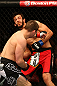 MONTREAL, QC - MARCH 16: Rick Story throws a punch to the face of Quinn Mulhern in their welterweight bout during the UFC 158 event at Bell Centre on March 16, 2013 in Montreal, Quebec, Canada.  (Photo by Jonathan Ferrey/Zuffa LLC/Zuffa LLC via Getty Images)