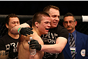 MONTREAL, QC - MARCH 16: Rick Story celebrates with his corner after defeating Quinn Mulhern in their welterweight bout during the UFC 158 event at Bell Centre on March 16, 2013 in Montreal, Quebec, Canada.  (Photo by Jonathan Ferrey/Zuffa LLC/Zuffa LLC via Getty Images)
