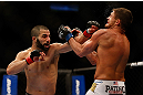 MONTREAL, QC - MARCH 16: John Makdessi punches Daron Cruickshank in their lightweight bout during the UFC 158 event at Bell Centre on March 16, 2013 in Montreal, Quebec, Canada.  (Photo by Jonathan Ferrey/Zuffa LLC/Zuffa LLC via Getty Images)