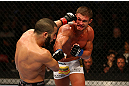 MONTREAL, QC - MARCH 16: Daron Cruickshank lands a punch on John Makdessi in their lightweight bout during the UFC 158 event at Bell Centre on March 16, 2013 in Montreal, Quebec, Canada.  (Photo by Jonathan Ferrey/Zuffa LLC/Zuffa LLC via Getty Images)