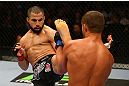 MONTREAL, QC - MARCH 16: John Makdessi lands a kick against Daron Cruickshank in their lightweight bout during the UFC 158 event at Bell Centre on March 16, 2013 in Montreal, Quebec, Canada.  (Photo by Jonathan Ferrey/Zuffa LLC/Zuffa LLC via Getty Images)