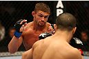 MONTREAL, QC - MARCH 16: (L-R) Daron Cruickshank fights against John Makdessi in their lightweight bout during the UFC 158 event at Bell Centre on March 16, 2013 in Montreal, Quebec, Canada.  (Photo by Jonathan Ferrey/Zuffa LLC/Zuffa LLC via Getty Images)