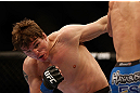 MONTREAL, QC - MARCH 16:  Darren Elkins punches Antonio Carvalhoin their featherweight bout during the UFC 158 event at Bell Centre on March 16, 2013 in Montreal, Quebec, Canada.  (Photo by Jonathan Ferrey/Zuffa LLC/Zuffa LLC via Getty Images)
