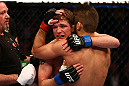 MONTREAL, QC - MARCH 16:  Darren Elkins hugs Antonio Carvalho after their featherweight bout during the UFC 158 event at Bell Centre on March 16, 2013 in Montreal, Quebec, Canada.  (Photo by Jonathan Ferrey/Zuffa LLC/Zuffa LLC via Getty Images)