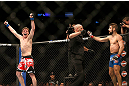 MONTREAL, QC - MARCH 16: Darren Elkins raises his hands in victory over Antonio Carvalho in their featherweight bout during the UFC 158 event at Bell Centre on March 16, 2013 in Montreal, Quebec, Canada.  (Photo by Jonathan Ferrey/Zuffa LLC/Zuffa LLC via Getty Images)