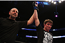 MONTREAL, QC - MARCH 16:  Referee raises Darren Elkins hand in victory over Antonio Carvalho in their featherweight bout during the UFC 158 event at Bell Centre on March 16, 2013 in Montreal, Quebec, Canada.  (Photo by Jonathan Ferrey/Zuffa LLC/Zuffa LLC via Getty Images)