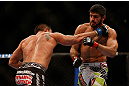 MONTREAL, QC - MARCH 16: (R-L) Patrick Cote fights against Bobby Voelker in their welterweight bout during the UFC 158 event at Bell Centre on March 16, 2013 in Montreal, Quebec, Canada.  (Photo by Jonathan Ferrey/Zuffa LLC/Zuffa LLC via Getty Images)