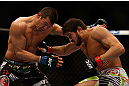 MONTREAL, QC - MARCH 16: (R-L) Patrick Cote lands a punch on Bobby Voelker in their welterweight bout during the UFC 158 event at Bell Centre on March 16, 2013 in Montreal, Quebec, Canada.  (Photo by Jonathan Ferrey/Zuffa LLC/Zuffa LLC via Getty Images)