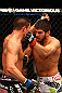 MONTREAL, QC - MARCH 16: (L-R) Patrick Cote fights against Bobby Voelker in their welterweight bout during the UFC 158 event at Bell Centre on March 16, 2013 in Montreal, Quebec, Canada.  (Photo by Jonathan Ferrey/Zuffa LLC/Zuffa LLC via Getty Images)