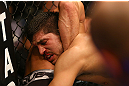 MONTREAL, QC - MARCH 16:  Bobby Voelker tries a choke on Patrick Cote in their welterweight bout during the UFC 158 event at Bell Centre on March 16, 2013 in Montreal, Quebec, Canada.  (Photo by Jonathan Ferrey/Zuffa LLC/Zuffa LLC via Getty Images)