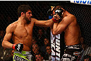 MONTREAL, QC - MARCH 16: (L-R) Patrick Cote lands a punch on Bobby Voelker in their welterweight bout during the UFC 158 event at Bell Centre on March 16, 2013 in Montreal, Quebec, Canada.  (Photo by Jonathan Ferrey/Zuffa LLC/Zuffa LLC via Getty Images)