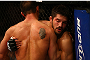 MONTREAL, QC - MARCH 16: (L-R) Patrick Cote and Bobby Voelker clinch in their welterweight bout during the UFC 158 event at Bell Centre on March 16, 2013 in Montreal, Quebec, Canada.  (Photo by Jonathan Ferrey/Zuffa LLC/Zuffa LLC via Getty Images)