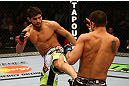 MONTREAL, QC - MARCH 16: (L-R) Patrick Cote lands a kick on Bobby Voelker in their welterweight bout during the UFC 158 event at Bell Centre on March 16, 2013 in Montreal, Quebec, Canada.  (Photo by Jonathan Ferrey/Zuffa LLC/Zuffa LLC via Getty Images)