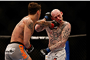 MONTREAL, QC - MARCH 16:  Mike Ricci lands a punch against Colin Fletcher in their lightweight bout during the UFC 158 event at Bell Centre on March 16, 2013 in Montreal, Quebec, Canada.  (Photo by Josh Hedges/Zuffa LLC/Zuffa LLC via Getty Images)