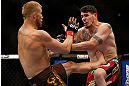 MONTREAL, QC - MARCH 16:  (L-R) Nick Ring kicks Chris Camozzi in their middleweight bout during the UFC 158 event at Bell Centre on March 16, 2013 in Montreal, Quebec, Canada.  (Photo by Josh Hedges/Zuffa LLC/Zuffa LLC via Getty Images)