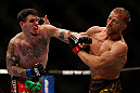 MONTREAL, QC - MARCH 16:  (L-R) Chris Camozzi punches Nick Ring in their middleweight bout during the UFC 158 event at Bell Centre on March 16, 2013 in Montreal, Quebec, Canada.  (Photo by Josh Hedges/Zuffa LLC/Zuffa LLC via Getty Images)