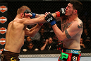 MONTREAL, QC - MARCH 16:  (L-R) Nick Ring punches Chris Camozzi in their middleweight bout during the UFC 158 event at Bell Centre on March 16, 2013 in Montreal, Quebec, Canada.  (Photo by Jonathan Ferrey/Zuffa LLC/Zuffa LLC via Getty Images)