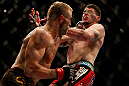 MONTREAL, QC - MARCH 16:  (L-R) Nick Ring punches Chris Camozzi in their middleweight bout during the UFC 158 event at Bell Centre on March 16, 2013 in Montreal, Quebec, Canada.  (Photo by Josh Hedges/Zuffa LLC/Zuffa LLC via Getty Images)