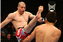 MONTREAL, QC - MARCH 16:  (L-R) Nate Marquardt kicks Jake Ellenberger in their welterweight bout during the UFC 158 event at Bell Centre on March 16, 2013 in Montreal, Quebec, Canada.  (Photo by Jonathan Ferrey/Zuffa LLC/Zuffa LLC via Getty Images)
