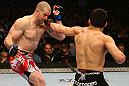 MONTREAL, QC - MARCH 16:  (R-L) Jake Ellenberger punches Nate Marquardt in their welterweight bout during the UFC 158 event at Bell Centre on March 16, 2013 in Montreal, Quebec, Canada.  (Photo by Jonathan Ferrey/Zuffa LLC/Zuffa LLC via Getty Images)