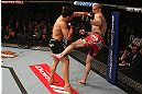 MONTREAL, QC - MARCH 16:  (L-R) Jake Ellenberger punches Nate Marquardt in their welterweight bout during the UFC 158 event at Bell Centre on March 16, 2013 in Montreal, Quebec, Canada.  (Photo by Jonathan Ferrey/Zuffa LLC/Zuffa LLC via Getty Images)