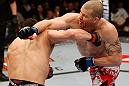 MONTREAL, QC - MARCH 16:  (L-R) Jake Ellenberger and \nm trade punches in their welterweight bout during the UFC 158 event at Bell Centre on March 16, 2013 in Montreal, Quebec, Canada.  (Photo by Josh Hedges/Zuffa LLC/Zuffa LLC via Getty Images)