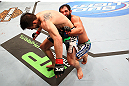 MONTREAL, QC - MARCH 16:  (R-L) Johny Hendricks attempts to take down Carlos Condit in their welterweight bout during the UFC 158 event at Bell Centre on March 16, 2013 in Montreal, Quebec, Canada.  (Photo by Jonathan Ferrey/Zuffa LLC/Zuffa LLC via Getty Images)