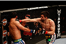 MONTREAL, QC - MARCH 16:  (R-L) Carlos Condit punches Johny Hendricks in their welterweight bout during the UFC 158 event at Bell Centre on March 16, 2013 in Montreal, Quebec, Canada.  (Photo by Josh Hedges/Zuffa LLC/Zuffa LLC via Getty Images)