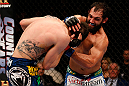 MONTREAL, QC - MARCH 16:  (R-L) Johny Hendricks punches Carlos Condit in their welterweight bout during the UFC 158 event at Bell Centre on March 16, 2013 in Montreal, Quebec, Canada.  (Photo by Josh Hedges/Zuffa LLC/Zuffa LLC via Getty Images)