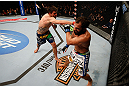 MONTREAL, QC - MARCH 16:  (L-R) Carlos Condit punches Johny Hendricks in their welterweight bout during the UFC 158 event at Bell Centre on March 16, 2013 in Montreal, Quebec, Canada.  (Photo by Josh Hedges/Zuffa LLC/Zuffa LLC via Getty Images)