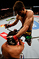 MONTREAL, QC - MARCH 16:  (R-L) Carlos Condit lands a flying knee against Johny Hendricks in their welterweight bout during the UFC 158 event at Bell Centre on March 16, 2013 in Montreal, Quebec, Canada.  (Photo by Josh Hedges/Zuffa LLC/Zuffa LLC via Getty Images)