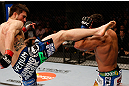 MONTREAL, QC - MARCH 16:  (L-R) Carlos Condit kicks Johny Hendricks in their welterweight bout during the UFC 158 event at Bell Centre on March 16, 2013 in Montreal, Quebec, Canada.  (Photo by Josh Hedges/Zuffa LLC/Zuffa LLC via Getty Images)