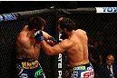 MONTREAL, QC - MARCH 16:  (R-L) Johny Hendricks punches Carlos Condit in their welterweight bout during the UFC 158 event at Bell Centre on March 16, 2013 in Montreal, Quebec, Canada.  (Photo by Jonathan Ferrey/Zuffa LLC/Zuffa LLC via Getty Images)