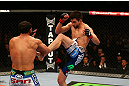 MONTREAL, QC - MARCH 16:  (R-L) Carlos Condit kicks Johny Hendricks in their welterweight bout during the UFC 158 event at Bell Centre on March 16, 2013 in Montreal, Quebec, Canada.  (Photo by Jonathan Ferrey/Zuffa LLC/Zuffa LLC via Getty Images)