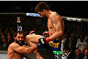 MONTREAL, QC - MARCH 16:  (R-L) Carlos Condit knees Johny Hendricks in their welterweight bout during the UFC 158 event at Bell Centre on March 16, 2013 in Montreal, Quebec, Canada.  (Photo by Jonathan Ferrey/Zuffa LLC/Zuffa LLC via Getty Images)