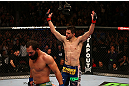 MONTREAL, QC - MARCH 16:  (R-L) Carlos Condit reacts after the conclusion of his welterweight bout against Johny Hendricks during the UFC 158 event at Bell Centre on March 16, 2013 in Montreal, Quebec, Canada.  (Photo by Jonathan Ferrey/Zuffa LLC/Zuffa LLC via Getty Images)