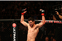 MONTREAL, QC - MARCH 16:  Carlos Condit reacts after the conclusion of his welterweight bout against Johny Hendricks during the UFC 158 event at Bell Centre on March 16, 2013 in Montreal, Quebec, Canada.  (Photo by Jonathan Ferrey/Zuffa LLC/Zuffa LLC via Getty Images)