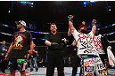 MONTREAL, QC - MARCH 16:  Johny Hendricks (R) reacts after defeating Carlos Condit in their welterweight bout during the UFC 158 event at Bell Centre on March 16, 2013 in Montreal, Quebec, Canada.  (Photo by Jonathan Ferrey/Zuffa LLC/Zuffa LLC via Getty Images)