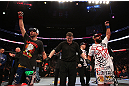 MONTREAL, QC - MARCH 16:  Johny Hendricks (R) and Carlos Condit (L) react as the judges&#39; scores are read after their welterweight bout during the UFC 158 event at Bell Centre on March 16, 2013 in Montreal, Quebec, Canada.  (Photo by Jonathan Ferrey/Zuffa LLC/Zuffa LLC via Getty Images)