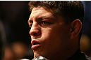 MONTREAL, QC - MARCH 16:  Nick Diaz prepares to enter the Octagon before his welterweight championship bout against Georges St-Pierre during the UFC 158 event at Bell Centre on March 16, 2013 in Montreal, Quebec, Canada.  (Photo by Jonathan Ferrey/Zuffa LLC/Zuffa LLC via Getty Images)