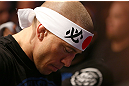 MONTREAL, QC - MARCH 16:  Georges St-Pierre prepares to enter the Octagon before his welterweight championship bout against Nick Diaz during the UFC 158 event at Bell Centre on March 16, 2013 in Montreal, Quebec, Canada.  (Photo by Jonathan Ferrey/Zuffa LLC/Zuffa LLC via Getty Images)