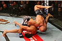 MONTREAL, QC - MARCH 16: (L-R) Georges St-Pierre flips Nick Diaz to the ground in their welterweight championship bout during the UFC 158 event at Bell Centre on March 16, 2013 in Montreal, Quebec, Canada.  (Photo by Jonathan Ferrey/Zuffa LLC/Zuffa LLC via Getty Images)