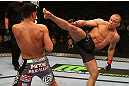 MONTREAL, QC - MARCH 16:  (R-L) Georges St-Pierre throws a kick against Nick Diaz in their welterweight championship bout during the UFC 158 event at Bell Centre on March 16, 2013 in Montreal, Quebec, Canada.  (Photo by Jonathan Ferrey/Zuffa LLC/Zuffa LLC via Getty Images)