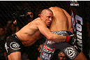 MONTREAL, QC - MARCH 16: (L-R) Georges St-Pierre grapples against Nick Diaz in their welterweight championship bout during the UFC 158 event at Bell Centre on March 16, 2013 in Montreal, Quebec, Canada.  (Photo by Jonathan Ferrey/Zuffa LLC/Zuffa LLC via Getty Images)